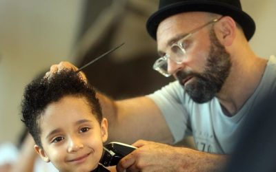 Molendinar boy Izaiah Smith gets his curly locks of hair cut for charity and loves his do